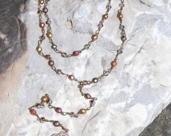 Multi color double wrap lariat with bronze cross