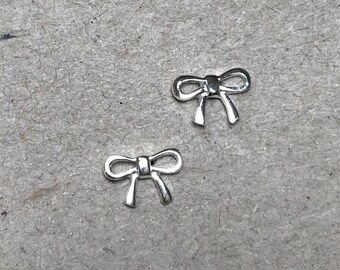Dainty sterling silver bow stud