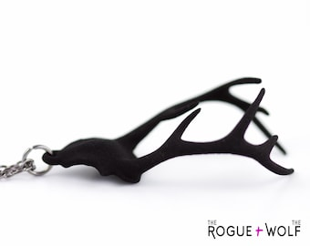 """The """"Remember"""" necklace in black - An antler necklace with a hidden heart within its curves."""