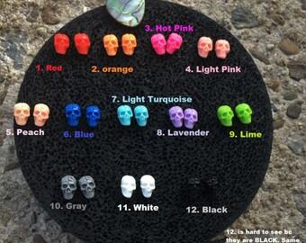 Tiny resin skull earring studs
