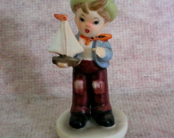Inarco Figurine of Boy with  Sail Boat - 2602