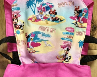 Surfs up Minnie Mouse baby doll/stuffed animal carrier