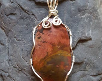 Natural rosy-pink stone wrapped in silver