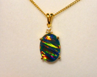 Lab Created, Sterling Silver, Gold Plate & CZ Triplet Opal Pendant 14x10mm Oval.item 70688.