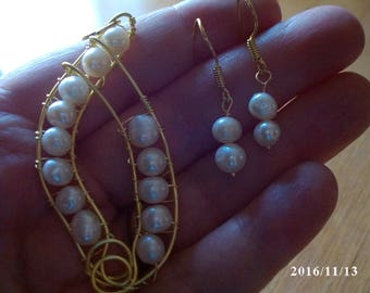 White pearl pendant and earring set wrapped in gold plated wire