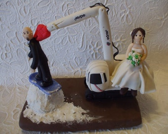 Customized bride on crane  & groom on snowboard wedding cake topper