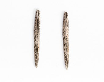 Golden spear earrings