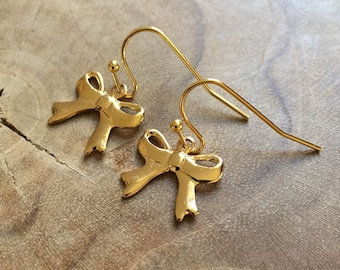 Take a bow - dangling earrings with goldtone metal bow charms. Cute and stylish