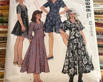 McCall's 90s Girls Dress Sewing Pattern / Vintage Retro Flared Empire Waist Dress and Jumpsuit or Romper / Sizes 10-14 / 6986
