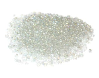 10 grams seed beads transparent iridescent Rainbow glass 2mm approximately 800 beads (ref42)