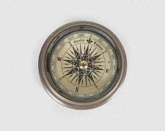 brown brass compass