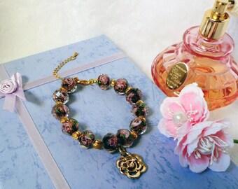 Burgundy rose glass bead bracelet with gold rose charm