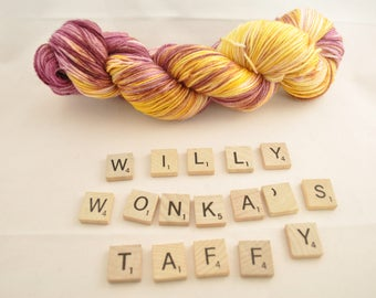 "Hand-dyed yarn, ""Willy Wonka's Taffy"" variegated, soft and squishy yarn. Great for socks or shawls. 80/20 Superwash wool/Nylon"