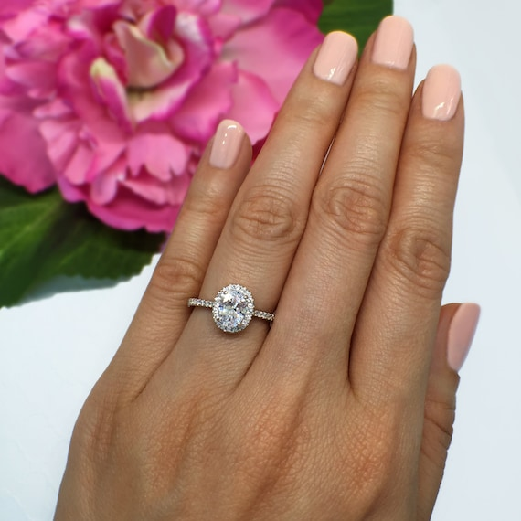 Oval Engagement Ring With Halo On Hand