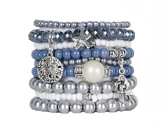 Beaded Bracelets Set of 9 Stretch Bracelets Bohemian Beach Themed Stack with Silver Tone Charms and Tassel