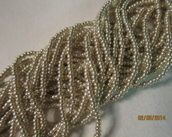 11/0, Preciosa, Czech Seed Beads, Metallic Silver #18303 - Available in 1/2 (6 strand) & Full (12-strand) Hanks