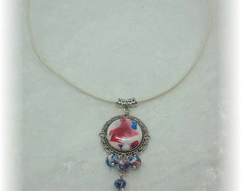 Necklace pendant red white and blue swirls