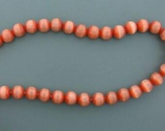 8mm burnt orange round fiber optic gemstone bead strand