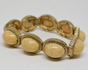 Charming gold tone stretchable bracelet