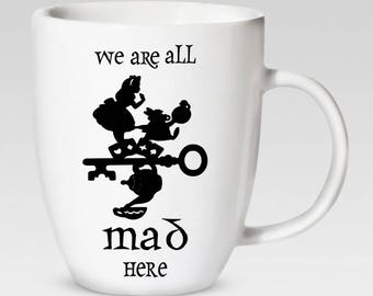 We Are All Mad Here - Alice in Wonderland 12 oz. Coffee Cup - Coffee Mug - 46 Different Colors Available