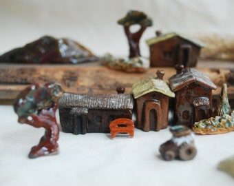 Ceramic toy set of tiny houses, trees and mountain