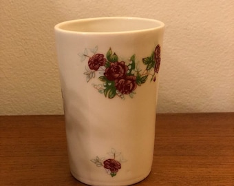 Handmade vintage style cup with a flower decal