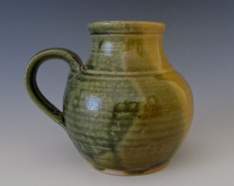 Mug or Vase.  Light & Dark Olive Green, Greenish Gold.  Stylized Form