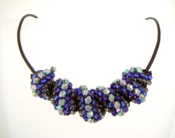 Stormy Blue Cellini Spiral blue and gray beaded statement necklace on leather cord