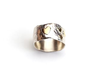 Heart ring. 9K heart ring .Sterling silver ring with 9K heart of gold .