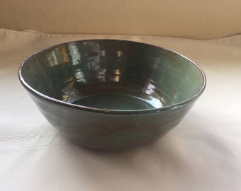 green stoneware bowl with brown accent