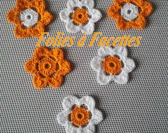 Crocheted in white cotton and orange flowers