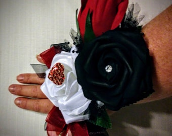 Harley Quinn/Queen of hearts wrist corsage and free boutonnière