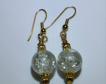 Crystal clear crackle glass earrings with gold accents hung from gold hypoallergenic hooks