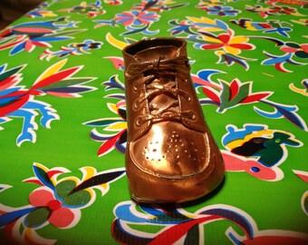 Vintage bronzed baby shoe