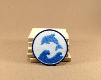 A Dolphin playing with wave in the ocean - Iron on Patch