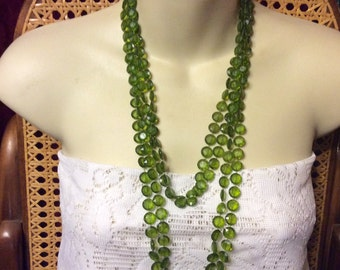Vintage double strand green faceted acrylic beads flapper length necklace.