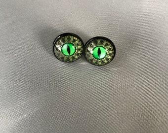 Steampunk green eye earrings