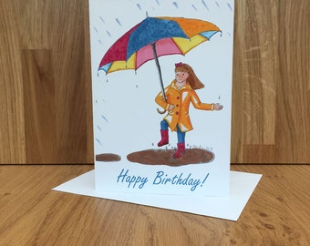 Little girl with coloured umbrella birthday card, singing in the rain