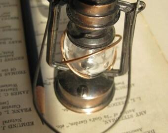 Hurricane lamp pencil sharpener. Cast metal.