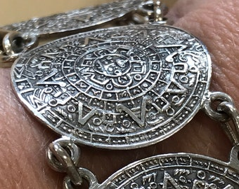 Beautiful vintage solid slver Mexican Aztec sundial linked panel bracelet