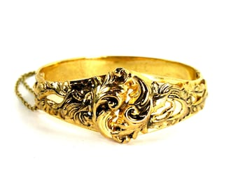 Antique Art Deco Whiting and Davis Repousse Clamper Bracelet Gold Bangle Leaves Scrolls circa 1930