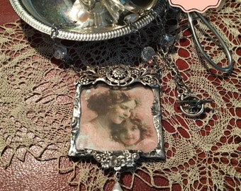 Mother's Love Pendant welded in silver alloy with natural pearls and crystals. #Solderedjewelry, #underglass