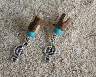 Earring made of wood with turquoise bead and music note