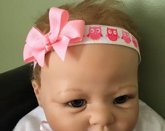pink owl headband with pink bow, sized 0-3 months.