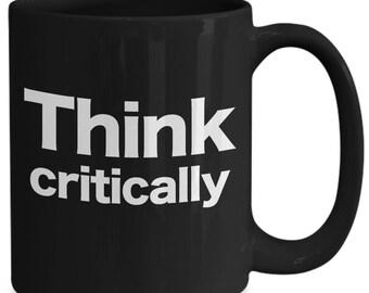 Critical thinking black coffee mug