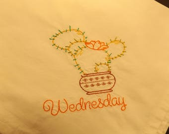 Dish towel set of 7 with different applique cacti and days of week.