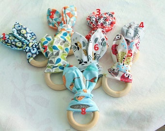 1 rattle with rabbit ears for baby