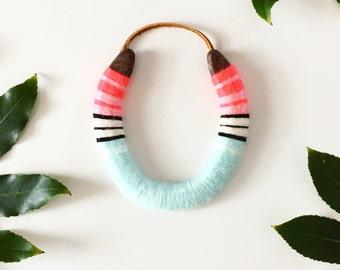 lucky yarned horseshoe in pastel watermelon