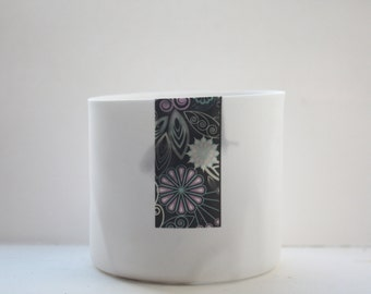 English fine white bone china vessel or tea light holder in stoneware with a flower strip and a black feather - illustrated ceramic