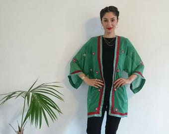 Apple green kimono style jacket with a red border and sequined flowers throughout
